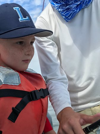 Kids Fishing Billy Bee Charters: Reeling in the shark. Patience paid off.