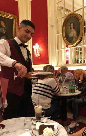 Cafe Sacher Wien: Our waiter pouring the Chocolate Likor into our coffee