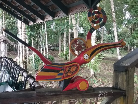 Kinabatangan District, Malaysia: Attention to detail; artwork and a ready supply of umbrellas at every turn