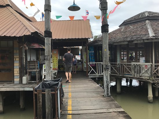 Pattaya Floating Market: pretty ramshackle walkways rotted in spots..no safety rails