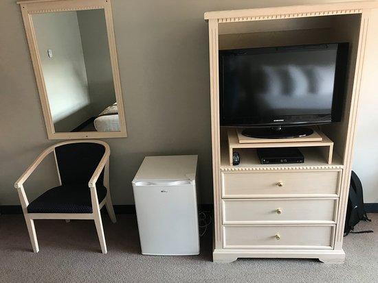 Quarterdeck Inn & Marina Resort: left to right: comfy chair, second fridge in room; dresser and flatscreen TV