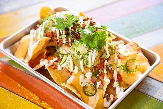 Barrio Soho: Barrio fiesta sized loaded Nachos - you can have them meaty, veggie or vegan!