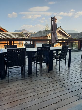 InterContinental Lijiang Ancient Town Resort: view from inside one of the dining areas.