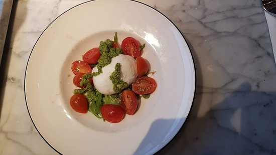 Mozzarela Cheese With Tomatoes And Pesto Sauce Picture Of