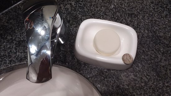 Drury Inn & Suites Denver Near the Tech Center: Huge hockey puck for soap! (That's a nickel next to it)