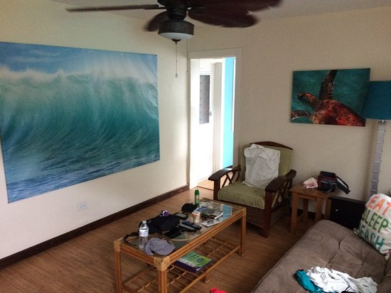 St. John Inn : living room in villa with art showing