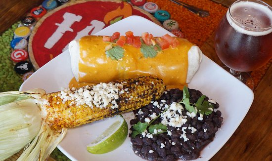 Lithia, FL: Burrito covered in queso, Mexican street corn (must try it) and black beans.