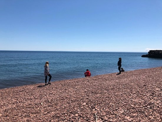 Two Harbors, MN: Kids skipping rocks into the lake