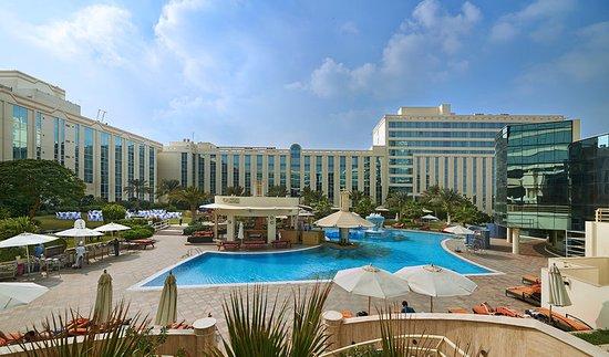 Millennium airport hotel dubai reviews prices - Dubai airport swimming pool price ...