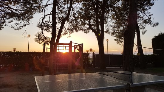 Miramare Camping Village: Sun setting over the play area
