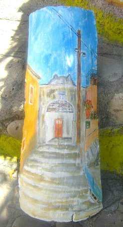 Chlomos, Greece: Roof tile painted.