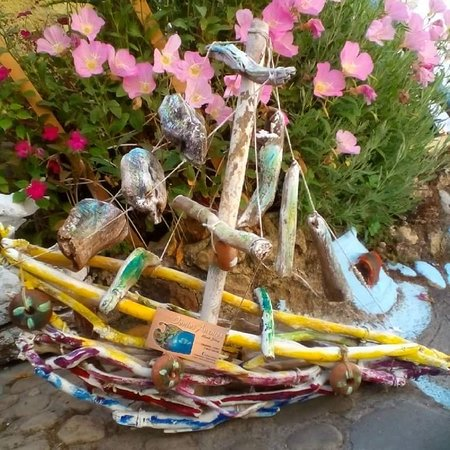 Chlomos, Greece: Drift wood art .