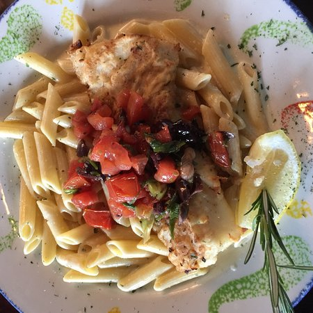 Parmesan crusted cod on penne pasta.