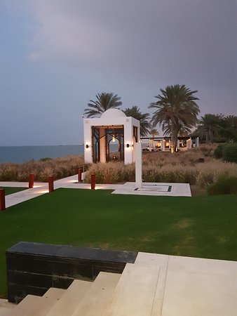 The Chedi Muscat: view from the long pool to the Chedi pool cabana/restaurant