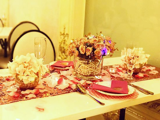 Pink And Gold Elegant Table Setting For Anniversary Celebration