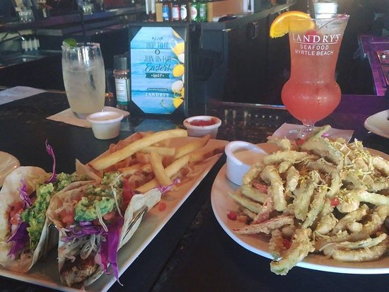 Landry's Seafood House: calamari, fish tacos with gold margarita and a mai tai