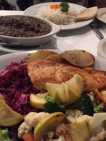 Highland Park, IL: broiled salmon with Persian herbed stew and rice pilaf in the background