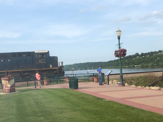 Freight train waiting at the Dubuque Riverwalk to cross the Mississippi
