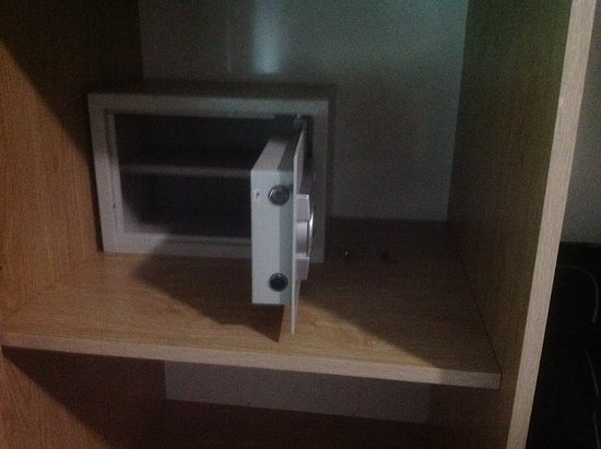 Blue River Hotel: Not even attached to cupboard, screws left beside Safe.