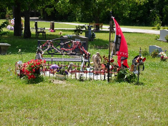McKinney, TX: Newer part of cemetery...benches, decorated plots are common