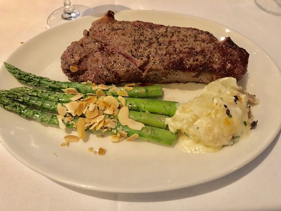 Del Frisco's Double Eagle Steak House: Prime Strip, Asperagus with roasted almonds and Uptown Del's Potato
