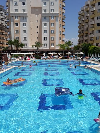 View on swimming pool, slides are to the left. - Picture of ...