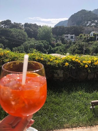 La Minerva: Laying by the pool with Kamal's famous Aperol Sprtiz. Best AS ever!