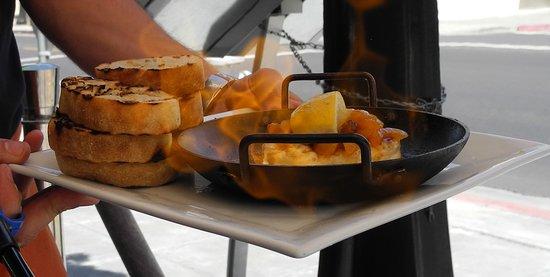 Tarla Mediterranean Bar & Grill: Saganaki (flaming cheese) with toasted bread)