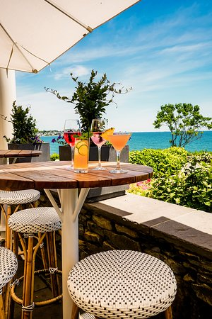 The Chanler at Cliff Walk: Sip cocktails on our outdoor terrace while enjoying stunning garden and oceanfront views.