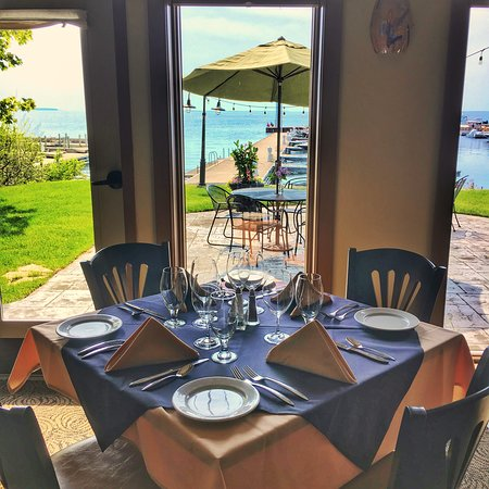 Waterfront Restaurant: Sunny Dining Room Table Overlooking the Green Bay