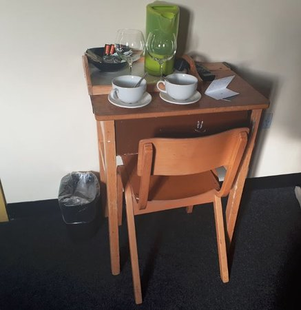Victoria Warehouse Hotel: The old school table and chair - It really was an old school table !
