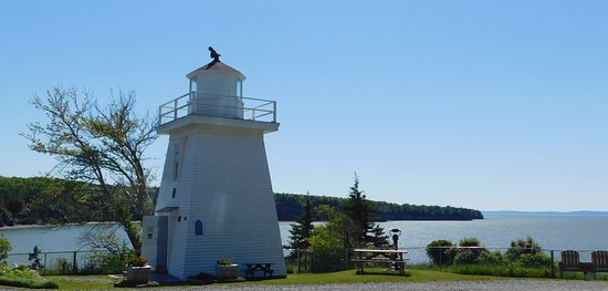 Walton Lighthouse with a view of Minas Basin in the distance