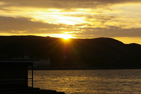 Bay County Hotel: Sunset over the Great Orme from the Hotel Steps