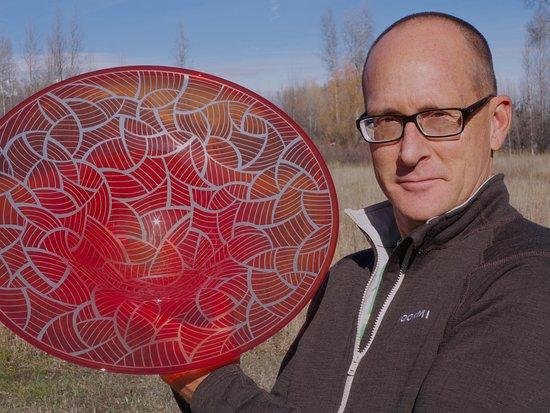 Thal Glass Studio: Dan Altwies holding a bowl that he sandblasted