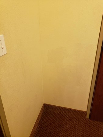 Holiday Inn Express Hotel & Suites Quincy I-10: dragged handprint on the wall and bad paint job covering something up.