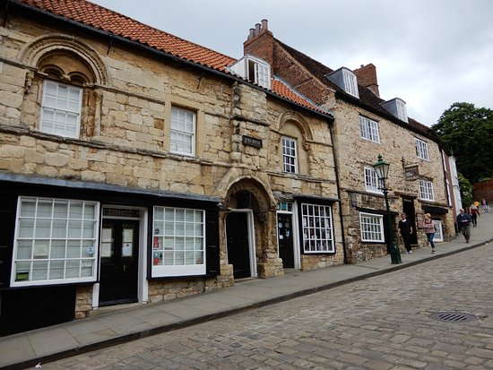 Steep Hill: Interesting buildings on the way up the hill - a bench to sit is opposite where this photo was t