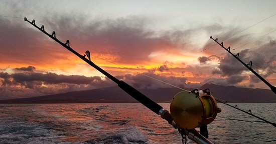 Start Me Up, Sport Fishing: Sunrise over west Maui. This would make the day even if we didn't get a bite!
