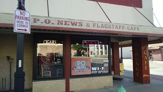 PO News & Flagstaff Cafe: The facade; note the 101 year banner in window.