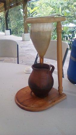 Zaragoza, El Salvador: a great cup of coffee being prepared