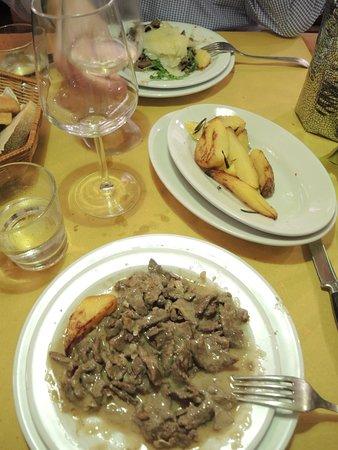 Taverna Lucifero : Secondi piatti - beef in Barolo sauce and Straccetti with rucola and parmesan.