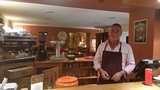 Simiane-la-Rotonde, France: Owner behind the bar