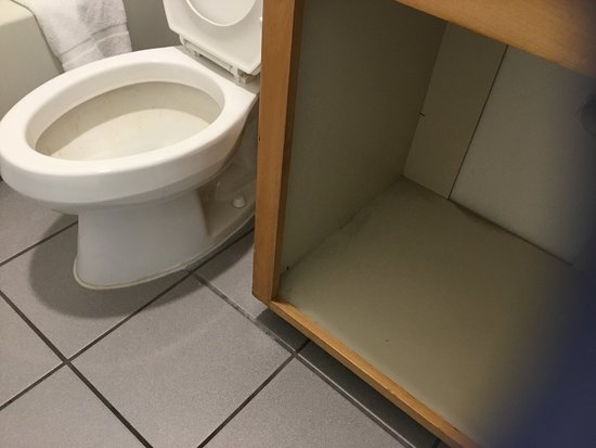 Filthy Room, Charges for Parking Car, Old furniture - not a place to stay