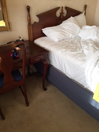 Town and Country San Diego: Really tall beds--mattress at same height as upper back of chair