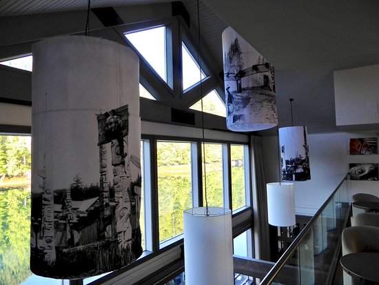 Moresby Island, Canada: Historic photos of Haida villages adorn lampshades over dining room