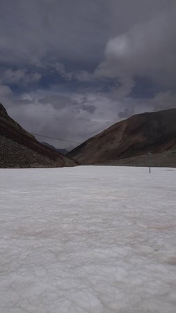 Tangtse, India: A  frozen stream on the way to Pangong lake from Chang La in May 2018