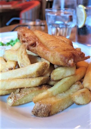 East Horsley, UK: Beer-battered fish and chips - healthy chips with their skins on
