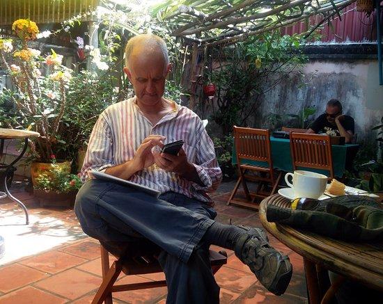 Cafe Malay - The Garden Cafe: A gentleman enjoying his coffee & wi-fi