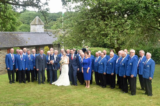 Builth Male Voice Choir with bride and groom at Reception at The Bleddfa Centre