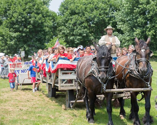 Living History Farms: Visitors participate in the town parade at the 1875 Independence Day celebration.
