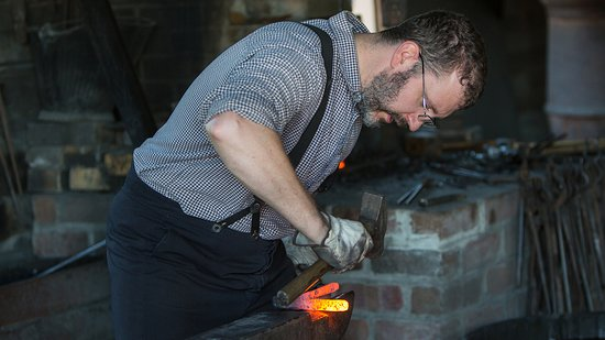 Living History Farms: Blacksmith working in the 1875 Town of Walnut Hill.